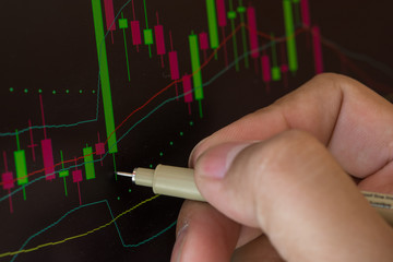 Hand and Stock exchange market business concept