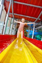 Little girl jumping in aquapark
