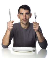 Man at dinner table isolated over white