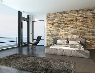 Modern sunny bedroom overlooking the ocean