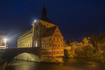 Obere bridge (brücke) and Altes Rathaus at night in Bamberg