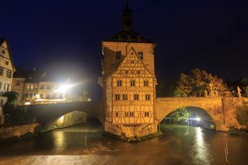 Obere bridge (brücke) and Altes Rathaus at night in Bamberg, Ge