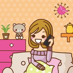 部屋で電話する女性