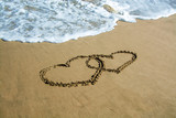 Two hearts drawn on the beach