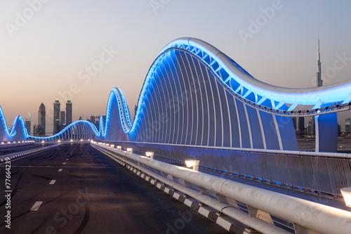 Fotobehang Midden Oosten Meydan Bridge in Dubai at night. United Arab Emirates