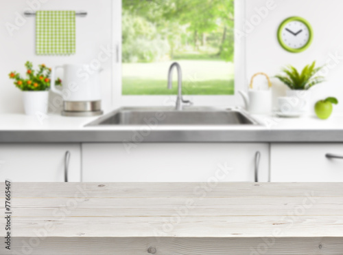 Wooden table on kitchen sink window background - 77665467