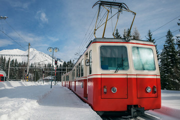 Red train on the mountain station in winter