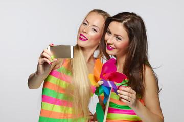 Girls taking selfie with smartphone