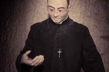 Close up Priest Statue in Black Attire
