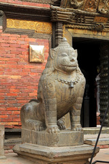 Stone lion guarding Patan Museum in Nepal