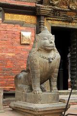 Stone lion guarding Patan Museum in Nepal