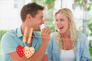 Composite image of hip young couple having desert together