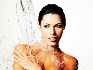 Woman with wet body and splashes of water