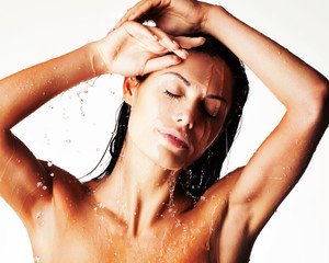 relaxing wet woman in shower under the water