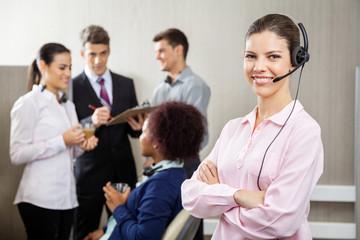 Confident Customer Service Representative Standing Arms Crossed