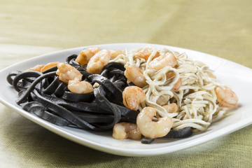 black pasta with seafood delicacies