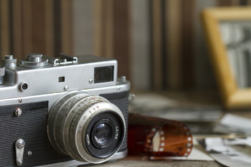 Old retro camera with pictures abstract background