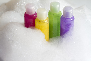 Colorful soaps cosmetics in the bathroom in foam abstract