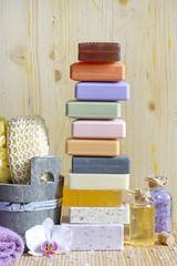 Pile of soaps with cosmetics for spa and body care