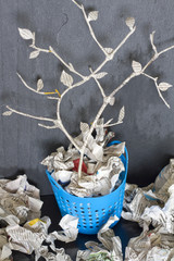 Paper tree in recycle trash can unique abstract concept