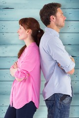 Composite image of irritated couple ignoring each other