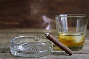 Cigar and whiskey abstract retro still life