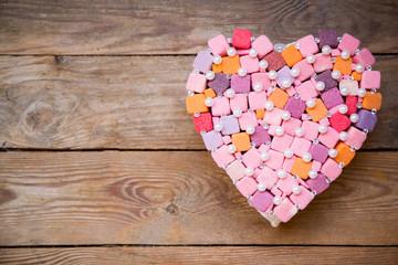 handmade multicolored heart on wood background