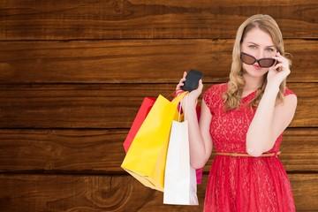 Cute woman holding shopping bags