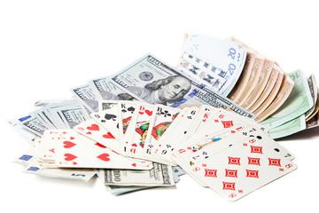 валюта и игральные карты на белом фоне