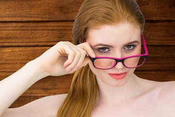 Composite image of beautiful redhead posing with glasses
