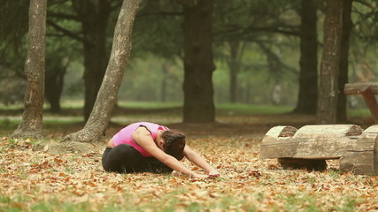 Girl stretching in the park