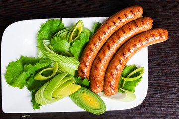Grilled sausages with easy side dish of leek and lettuce