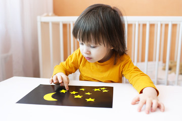 toddler made night sky and stars of paper details