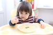 Toddler eating vegetable cream soup