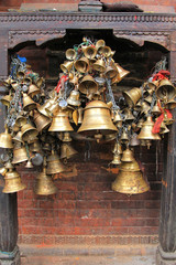 Metal sacrificial bells hanging on chain at Kumbeshwar Temple