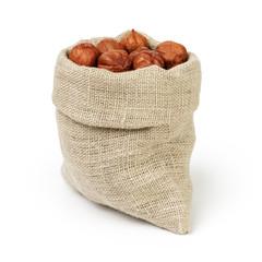 Fresh peeled hazelnuts in sack bag isolated