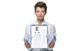 Постер, плакат: young woman ophthalmologist with eye chart