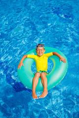Boy swims in a pool