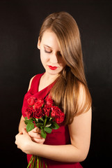 A young beautiful woman with roses
