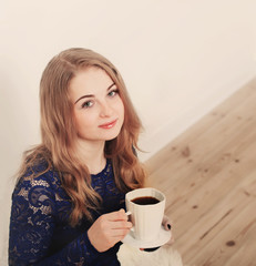beautiful girl with cup of coffee indoor