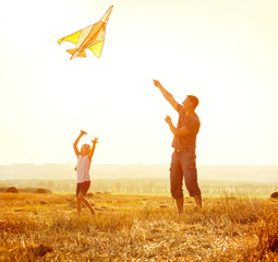 Dad with his daughter let a kite