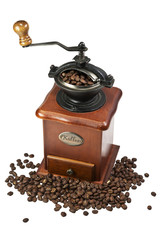 Retro manual coffee mill on roasted coffee beans isolated