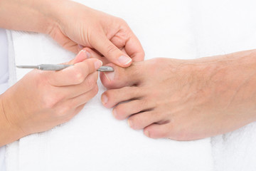 Manicurist Removing Cuticle From The Nail