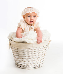 cute little girl in a wicker basket