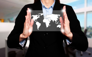 Businesswoman in dark suit holds world map global communication
