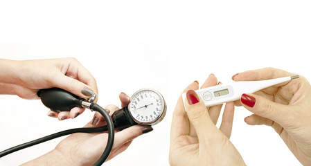 Electronic thermometer and blood pressure in women's hands