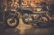 Vintage style cafe-racer motorcycle in customs garage - 77683607
