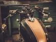Leinwandbild Motiv Vintage style cafe-racer motorcycle in customs garage