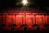 Fototapety Empty comfortable red seats with numbers in cinema