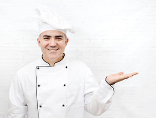 smiling chef in white uniform